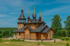 The Russian Church. Russian wooden Church with gold domes Stock Photos