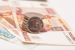 Russian coins on banknotes Stock Images