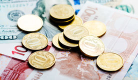 Russian  coins on dollars and euros Royalty Free Stock Photo