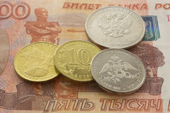 Russian coins on the five thousandth bill Royalty Free Stock Images