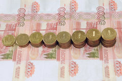 Russian Coins lie on the Russian banknotes. Of denomination of five thousand rubles Royalty Free Stock Image