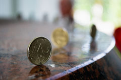 Russian coins standing on the granite table. Russian two-ruble-coin standing by edge on the granite table stock image