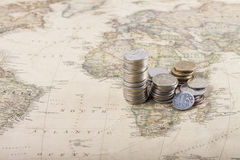 Russian coins on world map Royalty Free Stock Photo