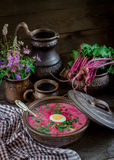 Russian cold soup with beetroot on dark wooden table. Stock Photos