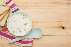 Russian cold vegetable soup on sour-milk base - okroshka. Raw cucumbers, radishes, sausage and boiled eggs & potatoes. Russian cold vegetable soup on sour-milk Stock Photo