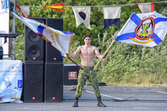 Russian commando with the flags of the Marine Corps Stock Images