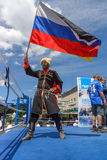 Russian Cossack with the Russian flag. BERLIN - JUNE 11, 2016: Russian Cossack with the Russian flag. German-Russian festival devoted to the Independence Day of Royalty Free Stock Photo