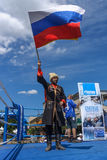 Russian Cossack with the Russian flag. BERLIN - JUNE 11, 2016: Russian Cossack with the Russian flag. German-Russian festival devoted to the Independence Day of stock image