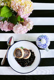 Russian cottage cheese cakes fried with flambe blueberries and tea Stock Images