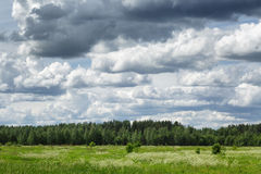 Russian countryside landskape with cloudy sky Stock Photography