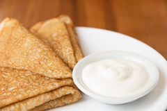 Russian crepes with sour cream Stock Image