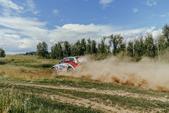 Russian crew of riders is riding in a rally car Stock Images
