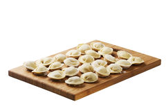 Russian crude pelmeni. Background from russian crude pelmeni laid out on a chopping board Royalty Free Stock Photos