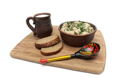 Russian cuisine: dumplings, cup of milk and bread on white backg Royalty Free Stock Photo