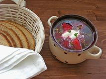 Russian and cuisine of Ukrain and Belarus traditional dish. Soup with red beets. Borsch with bread on wooden background royalty free stock photos