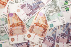 Russian currency coins and notes. On the background Royalty Free Stock Image