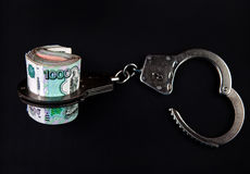 Russian Currency and Handcuffs Stock Image