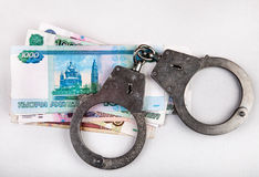Russian Currency and Handcuffs Royalty Free Stock Image
