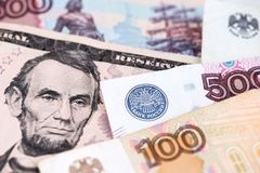 Russian currency Ruble banknotes and US Dollar bill. US Dollar and Russian Ruble currency banknotes. Close up image of US Dollar with Russian Rubles banknotes royalty free stock images