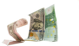 Russian currency ruble is standing on knees before dollar and euro Royalty Free Stock Photo