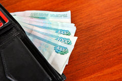 Russian Currency in the Wallet. On the Table closeup Stock Images