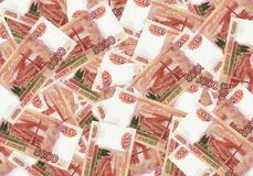 A stack of five thousand-ruble banknotes spread out money. Russian currency on a white background. Stock Image