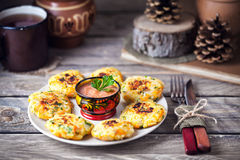 Russian cutlets on Shrovetide holidays. Russian vegan cutlets from potato and rice served with spicy tomato sauce in hohloma bowl on Shrovetide holidays Stock Photography