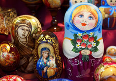 Russian decoration. Matrioska. Matrioska representing a young girl with flowers. On sale in a christmas street market Royalty Free Stock Images