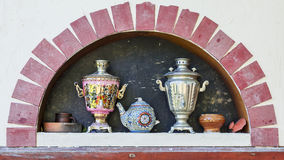 Russian decorative oven and samovars Royalty Free Stock Photo