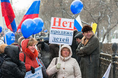 Russian demonstrators with poster with text No to  Royalty Free Stock Image