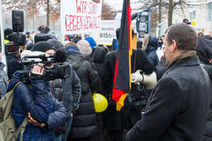 Russian Diaspora in Berlin protesting against migrants and refugees due to the sexual abuse of women and children. Royalty Free Stock Photos