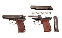 Russian disassembled handgun. On a white background Stock Photos