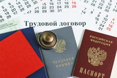 Russian documents for employment: passport, work book, diploma and seal. The inscription in Russian: a contract of employment stock photo