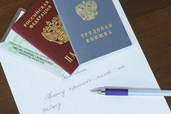 Russian documents passport, employment history, insurance certificate mandatory pension insurance on the handwritten statement of Stock Photo