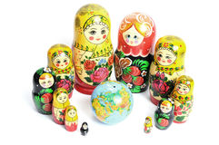 Russian doll around the world. Russian doll on the white around the world stock photos