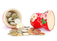 Russian doll with coins Stock Image