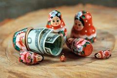Russian doll with dollars inside. Anti crisis money box. Matrioska bank. Royalty Free Stock Photos