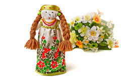 Russian doll in dress and a bouquet of flowers. Royalty Free Stock Photos
