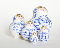 Russian doll Matryoshka family. Unique wooden Russian nested doll (Matryoshka) in white, which are arranged like a family together Royalty Free Stock Photography
