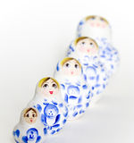 Russian doll Matryoshka family. An unique wooden hand painted nested doll (Matryoshka) arranged in a diagonal row with ascending order. Focusing on the second Stock Photo