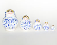 Russian doll Matryoshka in row. Unique wooden hand painted nested doll (Matryoshka), arranged in a row and isolated on white background Royalty Free Stock Photos