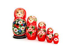 Russian dolls. Five wooden Russian dolls, isolated on white Stock Photography