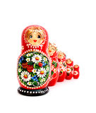 Russian Dolls. Five wooden Russian dolls standing one behind another. Isolated on white Royalty Free Stock Photo