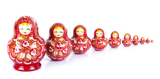 Russian dolls. A line of Russian matrehska dolls on white Stock Images