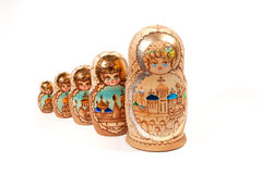 Russian Dolls. Five russian dolls in a line isolated on a white background royalty free stock images