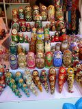 Russian dolls in market, all sizes all colors stock photos