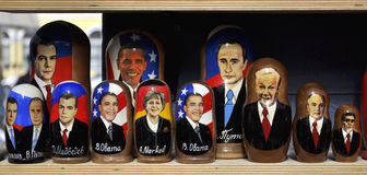 Russian dolls with politician portraits on sale. Russian souvenirs: decorative dolls with faces of politicians, on street sale Stock Image