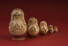 Russian dolls on a red background. A shot of Russian dolls on a red background Royalty Free Stock Images