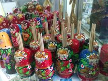 Russian dolls - toothpick holders on sale in a shop window royalty free stock images