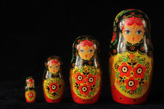 Russian dolls. Traditional russian dolls in a row on a black background Stock Image